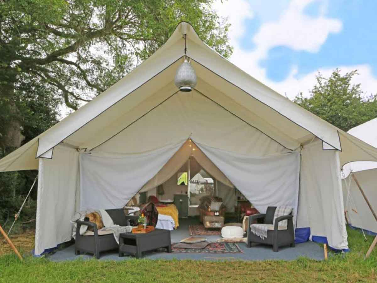 Safari tent glamping accommodation with en-suite bathroom for Glastonbury Fes